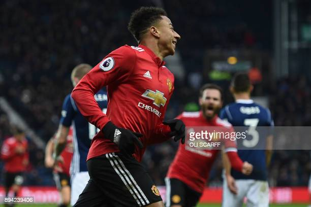 Manchester United's English midfielder Jesse Lingard celebrates after scoring their second goal during the English Premier League football match...