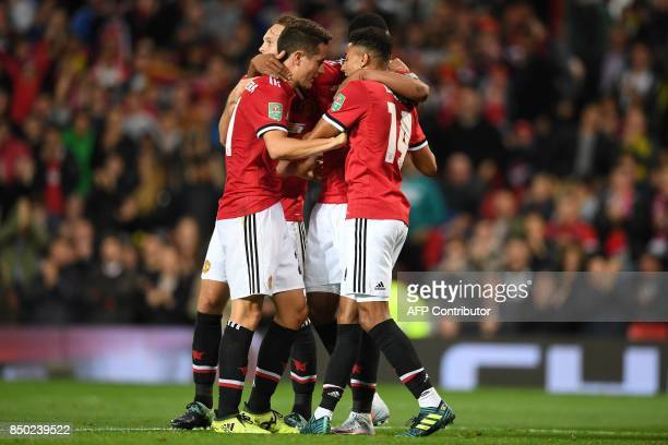 Manchester United's English midfielder Jesse Lingard celebrates scoring his team's third goal with teammates during the English League Cup third...