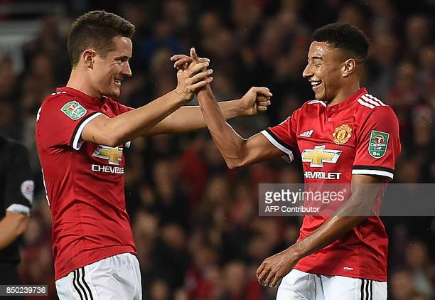Manchester United's English midfielder Jesse Lingard celebrates scoring his team's third goal during the English League Cup third round football...