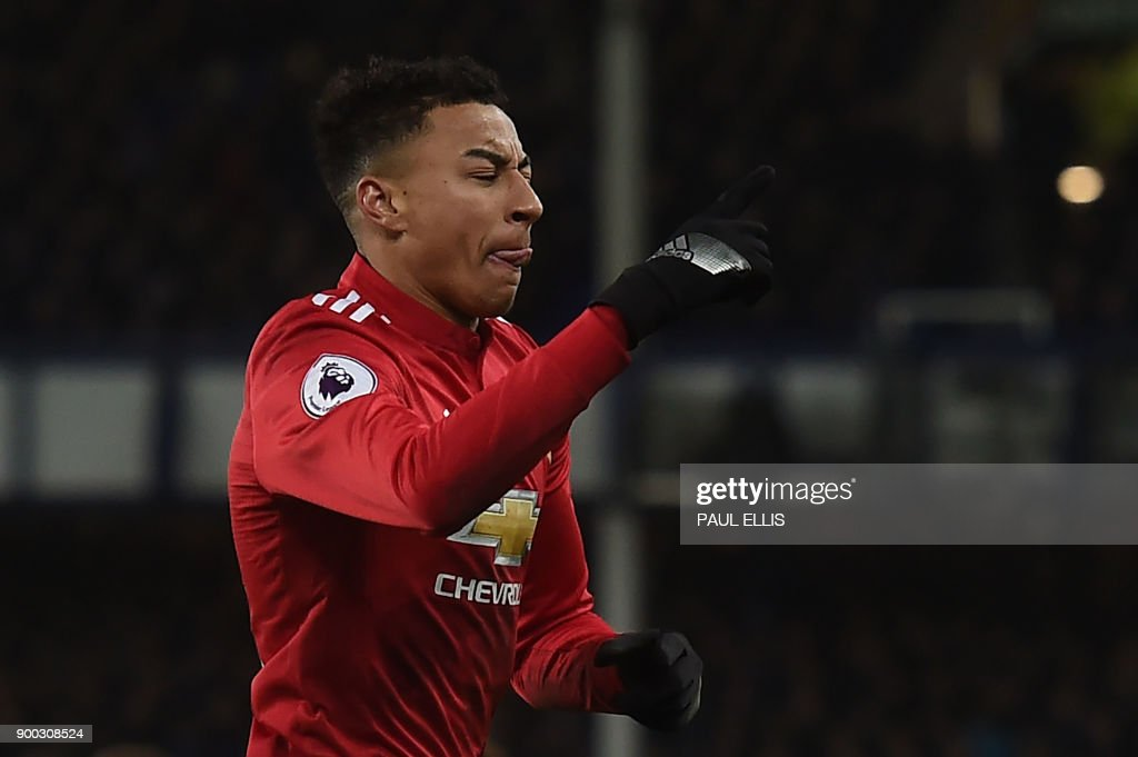 Manchester United's English midfielder Jesse Lingard celebrates scoring the team's second goal during the English Premier League football match between Everton and Manchester United at Goodison Park in Liverpool, north west England on January 1, 2018. / AFP PHOTO / PAUL ELLIS / RESTRICTED TO EDITORIAL USE. No use with unauthorized audio, video, data, fixture lists, club/league logos or 'live' services. Online in-match use limited to 75 images, no video emulation. No use in betting, games or single club/league/player publications. /