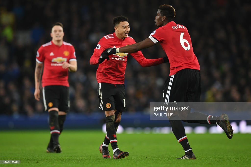 Manchester United's English midfielder Jesse Lingard (C) celebrates scoring the team's second goal with Manchester United's French midfielder Paul Pogba (R) during the English Premier League football match between Everton and Manchester United at Goodison Park in Liverpool, north west England on January 1, 2018. / AFP PHOTO / Paul ELLIS / RESTRICTED TO EDITORIAL USE. No use with unauthorized audio, video, data, fixture lists, club/league logos or 'live' services. Online in-match use limited to 75 images, no video emulation. No use in betting, games or single club/league/player publications. /