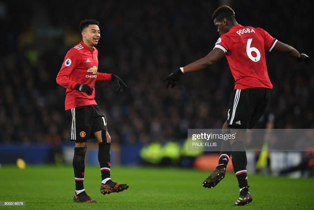 Manchester United's English midfielder Jesse Lingard (L) celebrates scoring the team's second goal with Manchester United's French midfielder Paul Pogba during the English Premier League football match between Everton and Manchester United at Goodison Park in Liverpool, north west England on January 1, 2018. / AFP PHOTO / Paul ELLIS / RESTRICTED TO EDITORIAL USE. No use with unauthorized audio, video, data, fixture lists, club/league logos or 'live' services. Online in-match use limited to 75 images, no video emulation. No use in betting, games or single club/league/player publications. /
