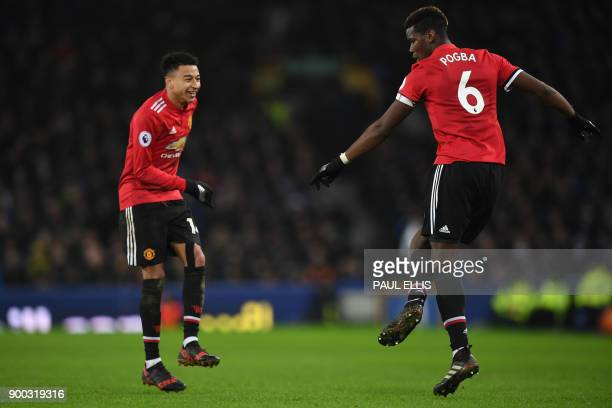 Manchester United's English midfielder Jesse Lingard celebrates scoring the team's second goal with Manchester United's French midfielder Paul Pogba...