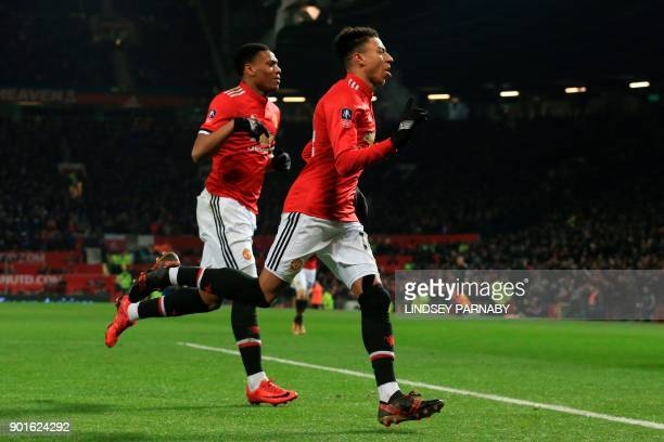 Manchester United's English midfielder Jesse Lingard celebrates scoring the opening goal during the English FA Cup third round football match between...
