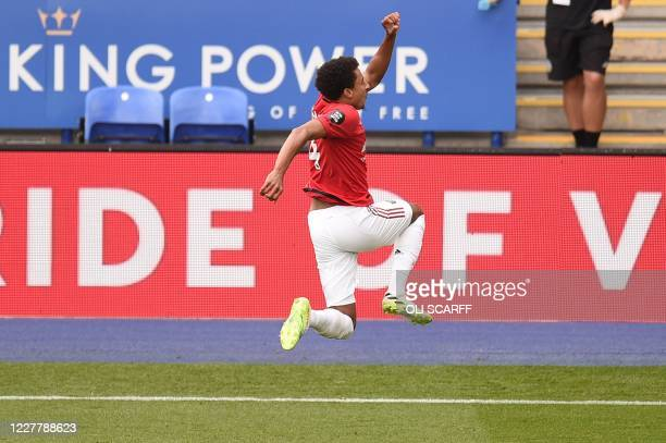 Manchester United's English midfielder Jesse Lingard celebrates scoring their second goal during the English Premier League football match between...