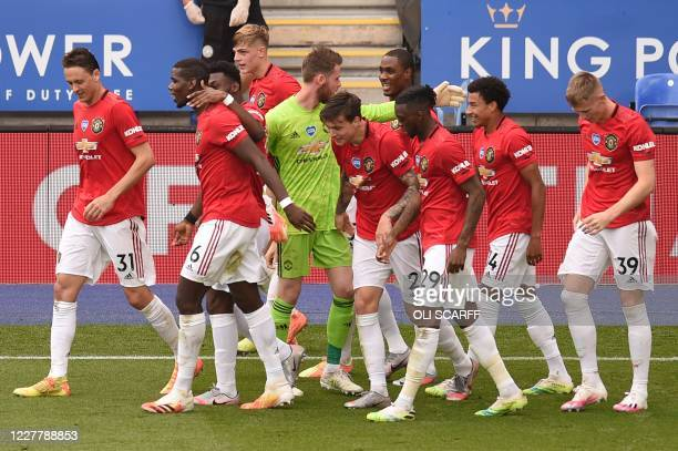 Manchester United's English midfielder Jesse Lingard celebrates scoring their second goal with teammates during the English Premier League football...