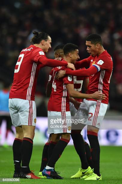 Manchester United's English midfielder Jesse Lingard celebrates scoring their second goal with Manchester United's Swedish striker Zlatan Ibrahimovic...