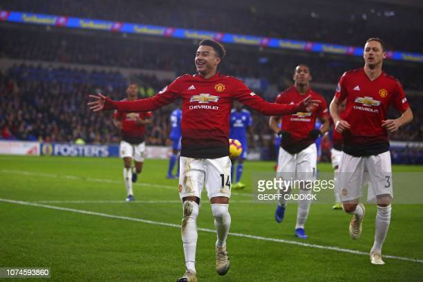 Manchester United's English midfielder Jesse Lingard celebrates with teammates after scoring their fourth goal from the penalty spot during the...
