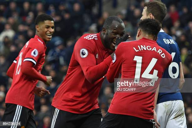 Manchester United's English midfielder Jesse Lingard celebrates with Manchester United's Belgian striker Romelu Lukaku after scoring their second...