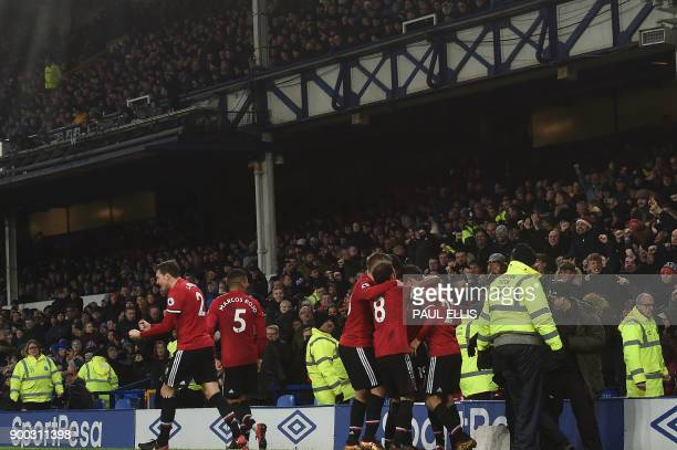 Manchester United's English midfielder Jesse Lingard celebrates with teammates scoring the team's second goal during the English Premier League...
