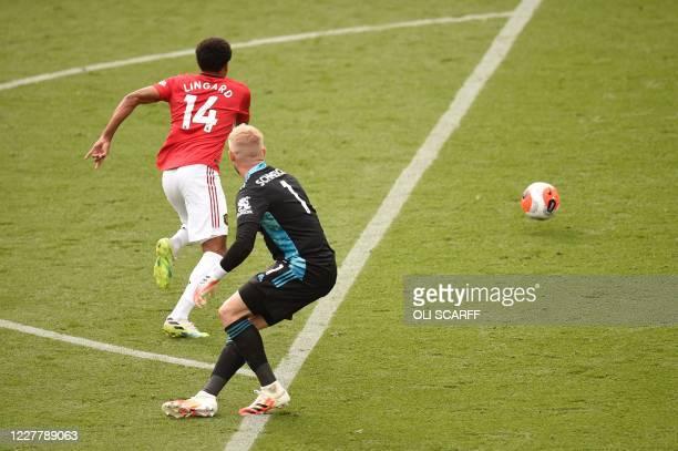 Manchester United's English midfielder Jesse Lingard dispossess Leicester City's Danish goalkeeper Kasper Schmeichel to score their second goal...