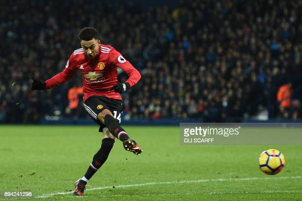 Manchester United's English midfielder Jesse Lingard has an unsuccessful shot during the English Premier League football match between West Bromwich...