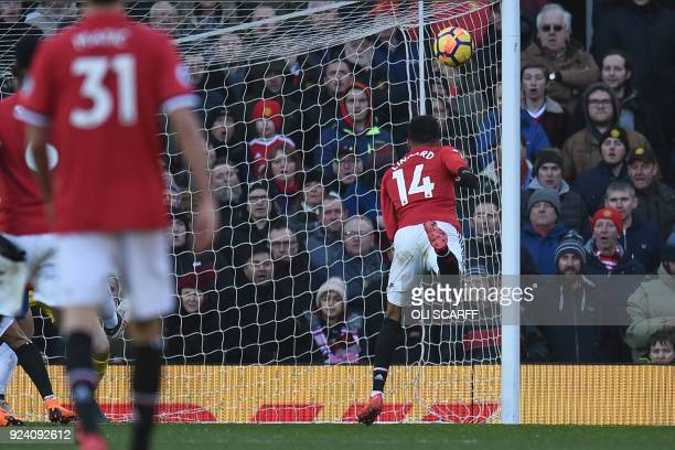 Manchester United's English midfielder Jesse Lingard heads United's second goal during the English Premier League football match between Manchester...
