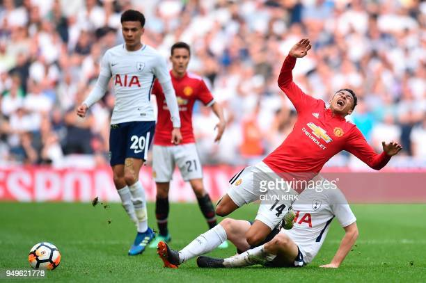 Manchester United's English midfielder Jesse Lingard is tackled by Tottenham Hotspur's English defender Eric Dier during the English FA Cup semifinal...