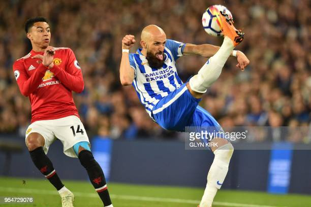 TOPSHOT Manchester United's English midfielder Jesse Lingard looks on as Brighton's Spanish defender Bruno Saltor clears the ball during the English...