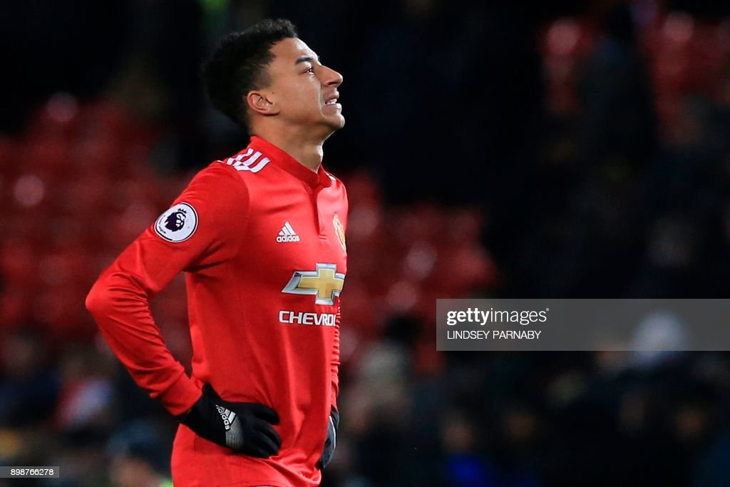 Manchester United's English midfielder Jesse Lingard reacts after the final whistle during the English Premier League football match between Manchester United and Burnley at Old Trafford in Manchester, north west England, on December 26, 2017. / AFP PHOTO / Lindsey PARNABY / RESTRICTED TO EDITORIAL USE. No use with unauthorized audio, video, data, fixture lists, club/league logos or 'live' services. Online in-match use limited to 75 images, no video emulation. No use in betting, games or single club/league/player publications. /