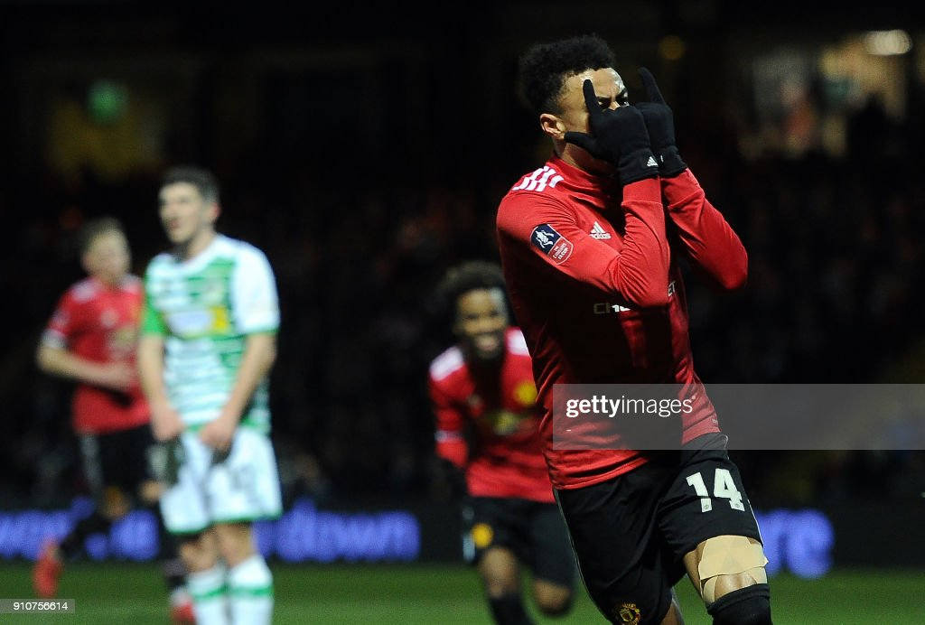 Manchester United's English midfielder Jesse Lingard reacts after scoring the team's third goal during the FA Cup fourth round football match between Yeovil Town and Manchester United at Huish Park in Yeovil, Somerset on January 26, 2018. / AFP PHOTO / - / RESTRICTED TO EDITORIAL USE. No use with unauthorized audio, video, data, fixture lists, club/league logos or 'live' services. Online in-match use limited to 75 images, no video emulation. No use in betting, games or single club/league/player publications. /