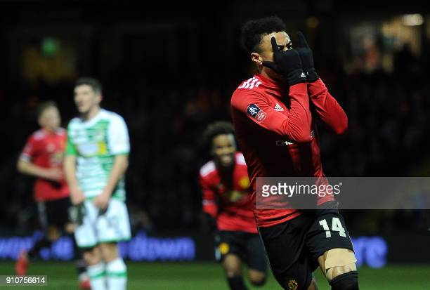 Manchester United's English midfielder Jesse Lingard reacts after scoring the team's third goal during the FA Cup fourth round football match between...