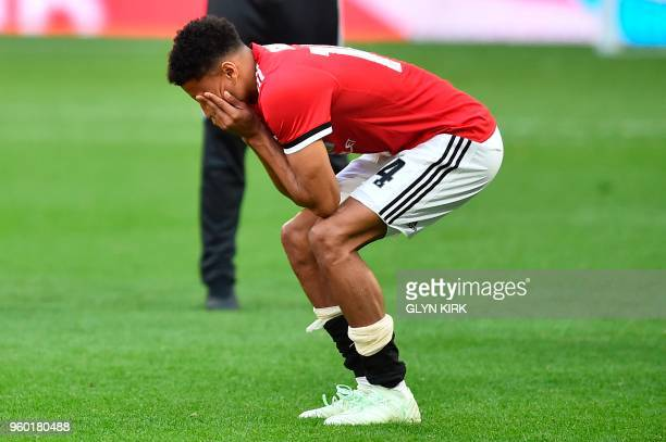 Manchester United's English midfielder Jesse Lingard reacts after losing the English FA Cup final football match between Chelsea and Manchester...