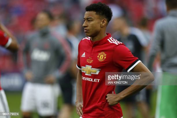 Manchester United's English midfielder Jesse Lingard reacts to their defeat on the pitch after the English FA Cup final football match between...