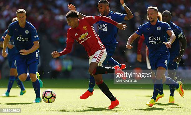 Manchester United's English midfielder Jesse Lingard runs through the Leicester defence to score the opening goal in the FA Community Shield football...