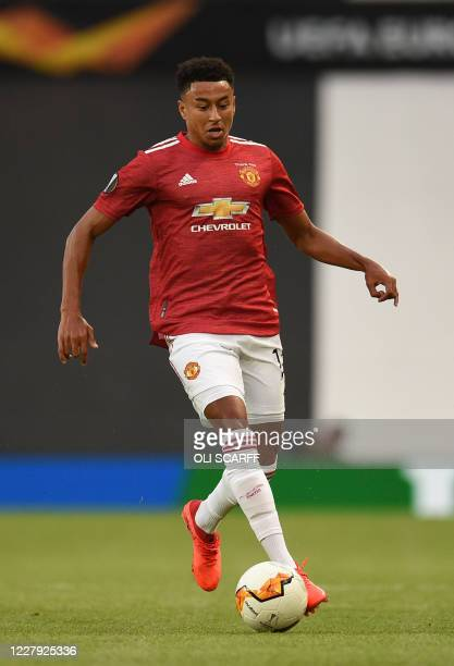 Manchester United's English midfielder Jesse Lingard runs with the ball during the UEFA Europa League last 16 second leg football match between...