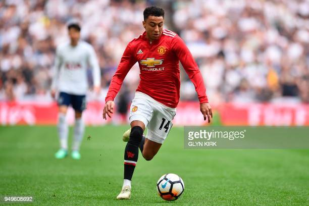 Manchester United's English midfielder Jesse Lingard runs with the ball during the English FA Cup semifinal football match between Tottenham Hotspur...