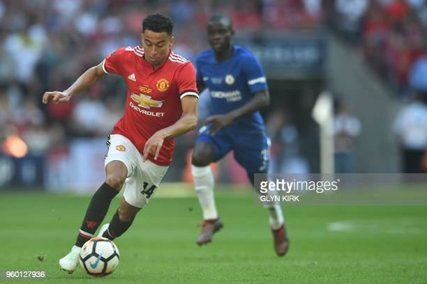 Manchester United's English midfielder Jesse Lingard runs with the ball during the English FA Cup final football match between Chelsea and Manchester...