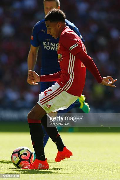 Manchester United's English midfielder Jesse Lingard scores the opening goal in the FA Community Shield football match between Manchester United and...