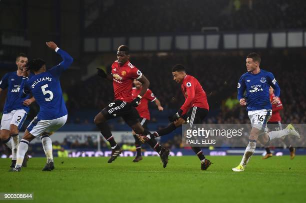 Manchester United's English midfielder Jesse Lingard scores the team's second goal during the English Premier League football match between Everton...