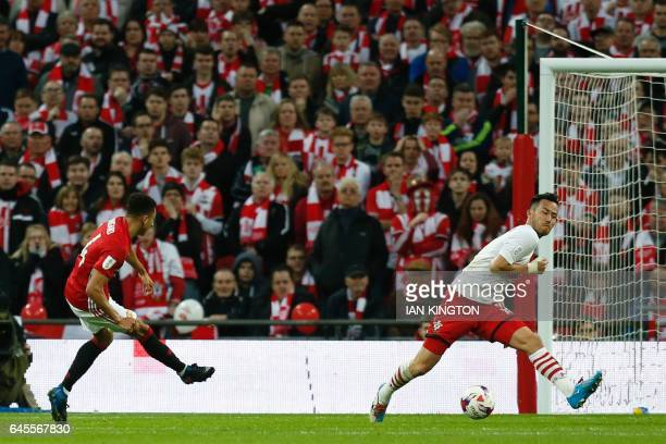 Manchester United's English midfielder Jesse Lingard scores their second goal during the English League Cup final football match between Manchester...