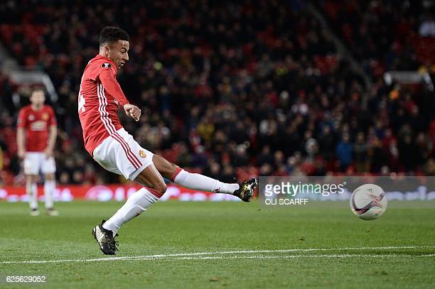 Manchester United's English midfielder Jesse Lingard shoots to score their fourth goal during the UEFA Europa League group A football match between...