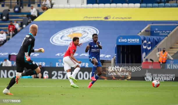 Manchester United's English midfielder Jesse Lingard slots the ball into an empty net to score their second goal after disposessing Leicester City's...