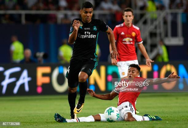 Manchester United's English midfielder Jesse Lingard tackles Real Madrid's Brazilian midfielder Casemiro during the UEFA Super Cup football match...