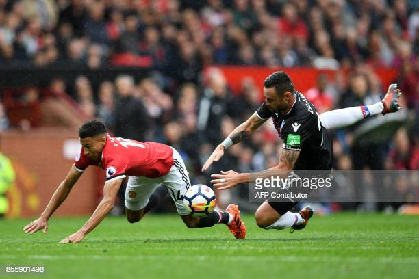 Manchester United's English midfielder Jesse Lingard vies with Crystal Palace's Irish defender Damien Delaney during the English Premier League...