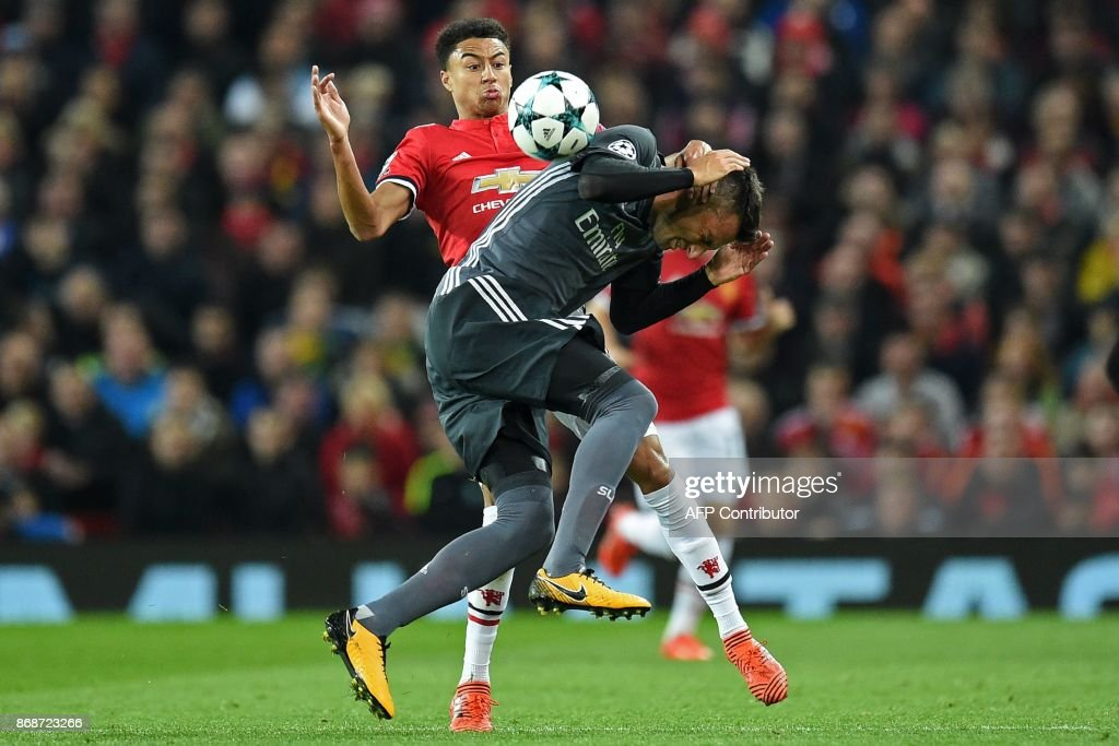 Manchester United's English midfielder Jesse Lingard (L) vies with Benfica's Greek midfielder Andreas Samaris during the UEFA Champions League Group A football match between Manchester United and Benfica at Old Trafford in Manchester, north west England on October 31, 2017. / AFP PHOTO / Oli SCARFF