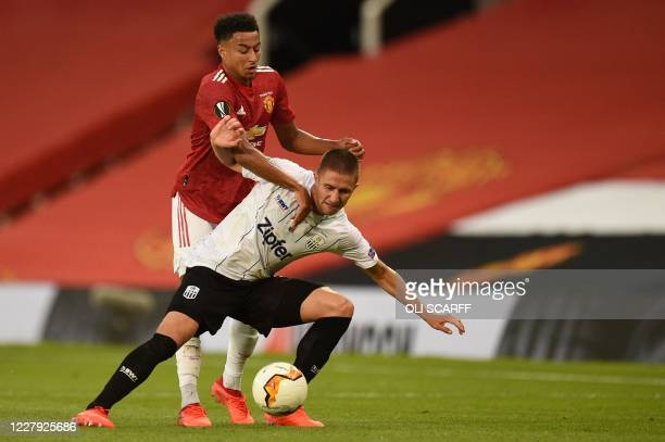 Manchester United's English midfielder Jesse Lingard vies with LASK's Austrian defender Reinhold Ranftl during the UEFA Europa League last 16 second...