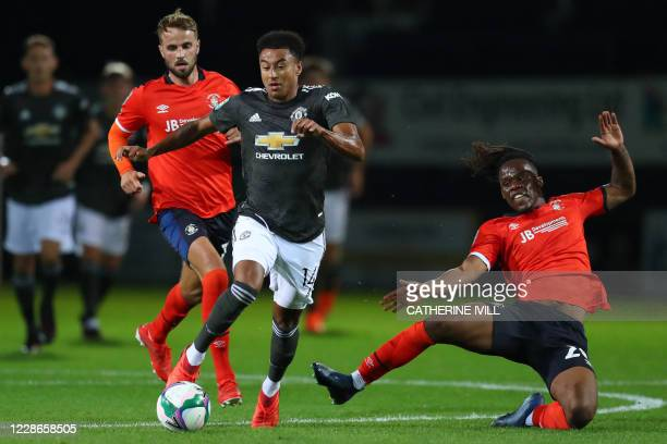 Manchester United's English midfielder Jesse Lingard vies with Luton Town's Irish defender Peter Kioso during the English League Cup third round...