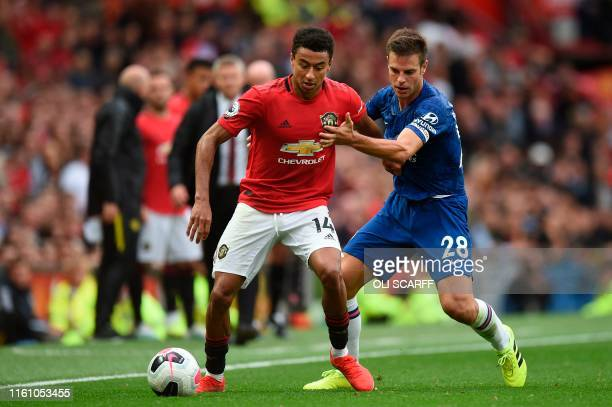 Manchester United's English midfielder Jesse Lingard vies with Chelsea's Spanish defender Cesar Azpilicueta during the English Premier League...