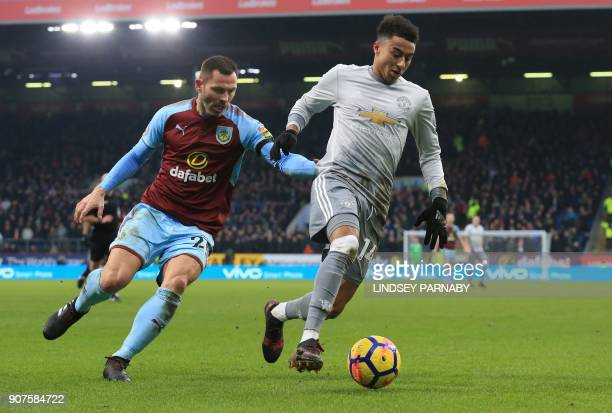 Manchester United's English midfielder Jesse Lingard vies with Burnley's Englishborn Scottish defender Phil Bardsley during the English Premier...