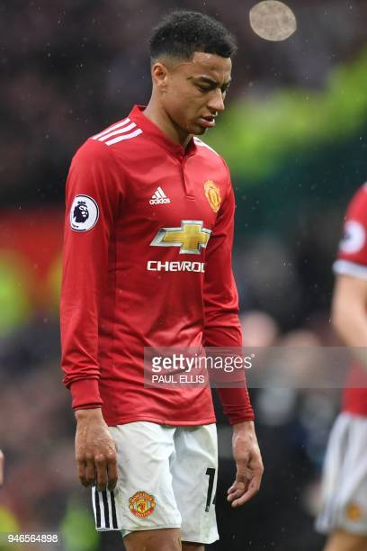 Manchester United's English midfielder Jesse Lingard walks off after the English Premier League football match between Manchester United and West...