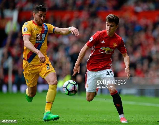 Manchester United's English midfielder Josh Harrop battles with Crystal Palace's English defender Joel Ward plays during the English Premier League...