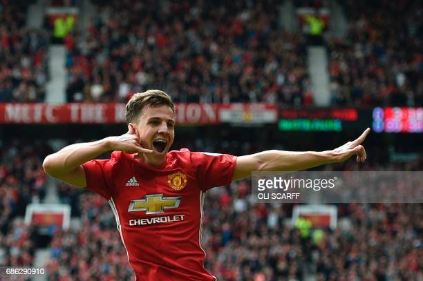 Manchester United's English midfielder Josh Harrop celebrates scoring thei opening goal during the English Premier League football match between...