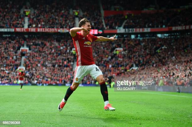 Manchester United's English midfielder Josh Harrop celebrates scoring the opening goal during the English Premier League football match between...
