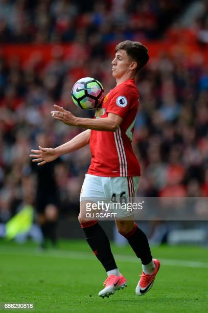 Manchester United's English midfielder Josh Harrop controls the ball during the English Premier League football match between Manchester United and...
