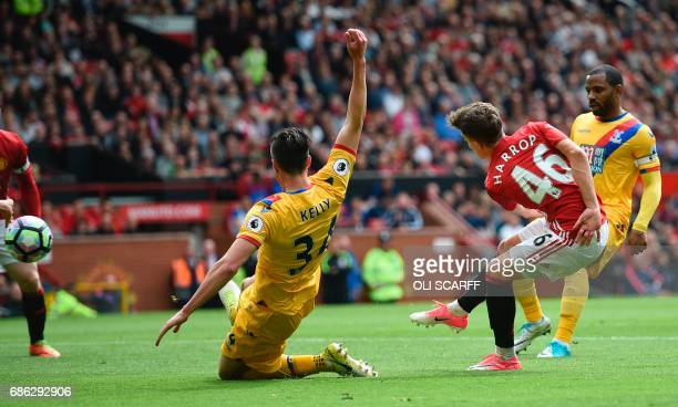 Manchester United's English midfielder Josh Harrop scores the opening goal during the English Premier League football match between Manchester United...