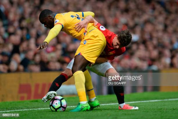 Manchester United's English midfielder Josh Harrop vies with Crystal Palace's German defender Jeffrey Schlupp during the English Premier League...