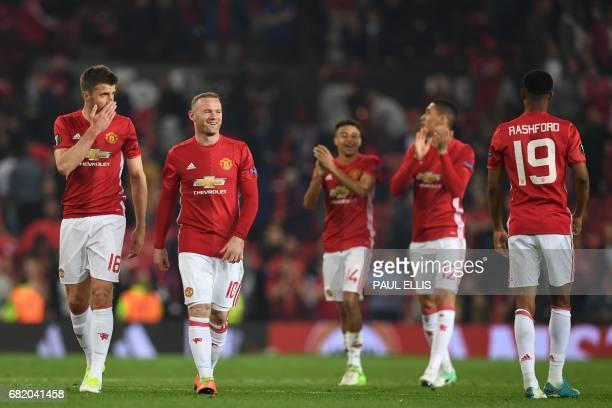 Manchester United's English midfielder Michael Carrick Manchester United's English striker Wayne Rooney Manchester United's English midfielder Jesse...