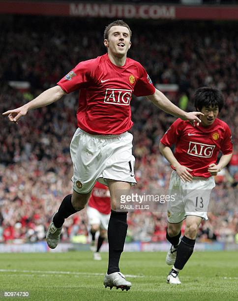 Manchester United's English midfielder Michael Carrick postulates after scoring against West Ham United during their English Premier League football...