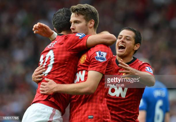 Manchester United's English midfielder Nick Powell celebrates scoring his goal with teammates during the English Premier League football match...